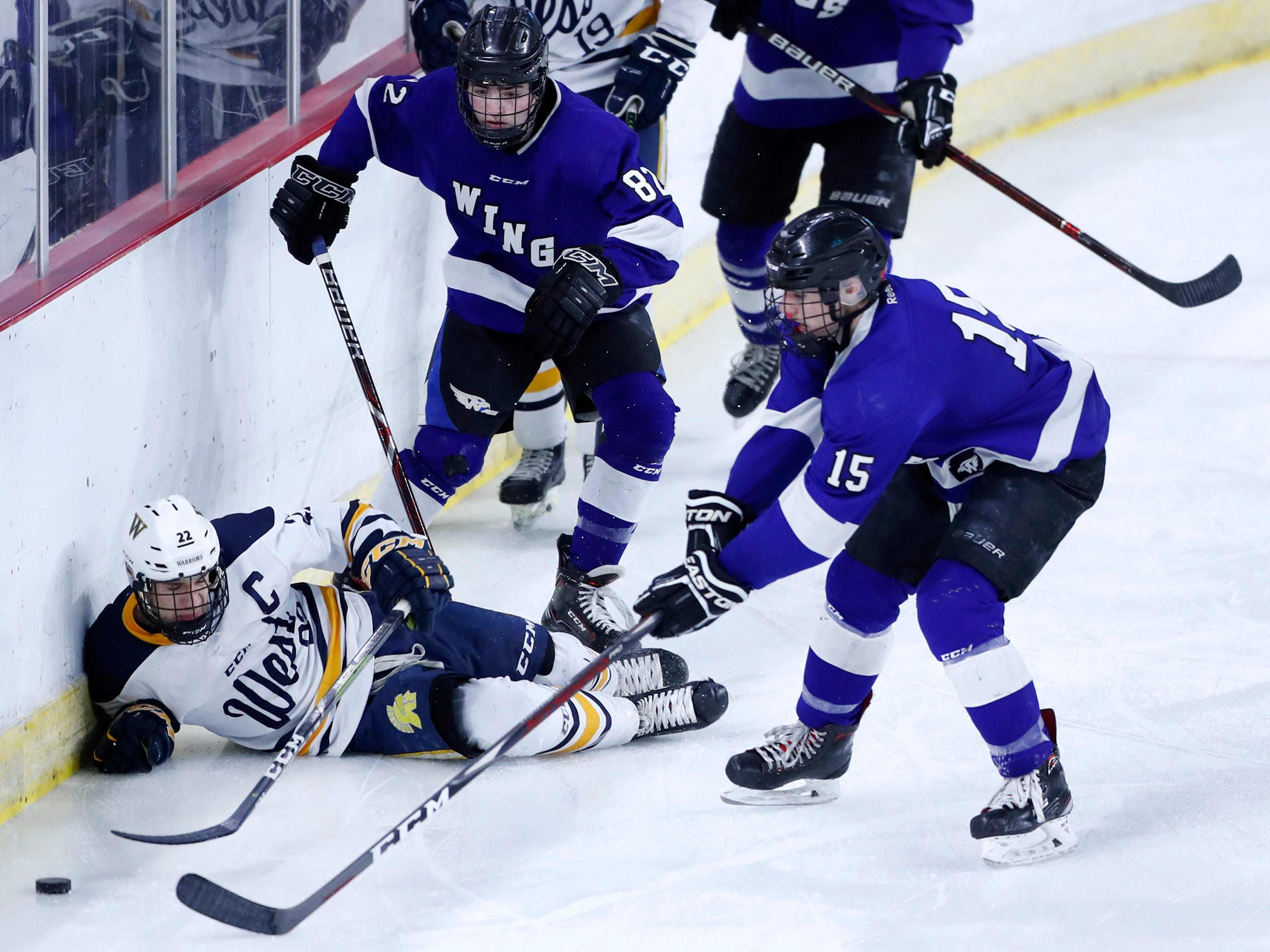 Waukesha North Co-op's Tyler Dale and Garrett Wilderman close in on Wausau West's Sam Techel after he fell to the ice during the WIAA State Hockey Tournament quarterfinals Thursday, Feb. 28, 2019, at Veterans Memorial Coliseum in Madison, Wis.