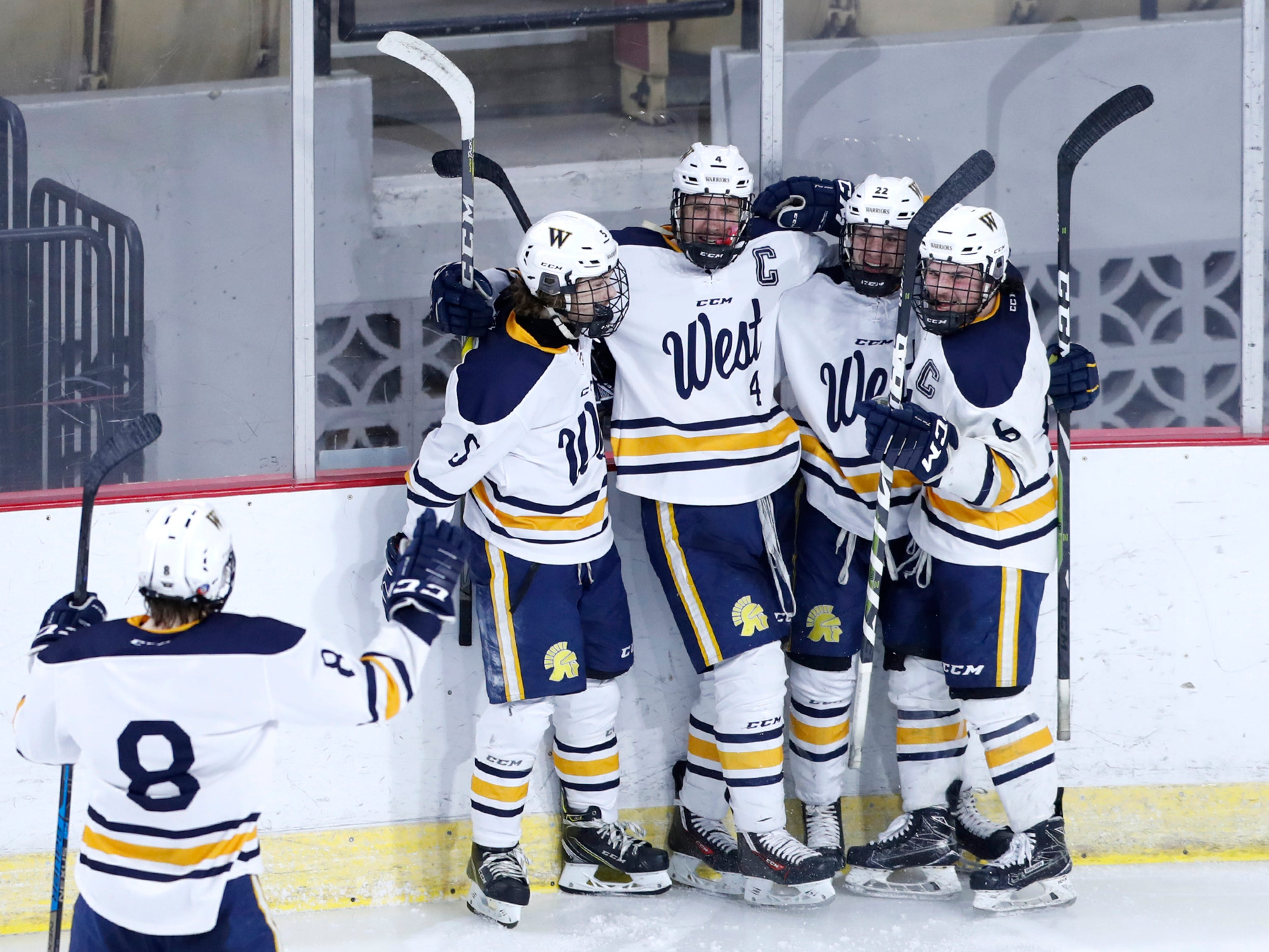 Wausau West's Connor Healy goes to celebrate with teammates after a goal scored by Sam Techel against Waukesha North Co-op during the WIAA State Hockey Tournament quarterfinals Thursday, Feb. 28, 2019, at Veterans Memorial Coliseum in Madison, Wis.