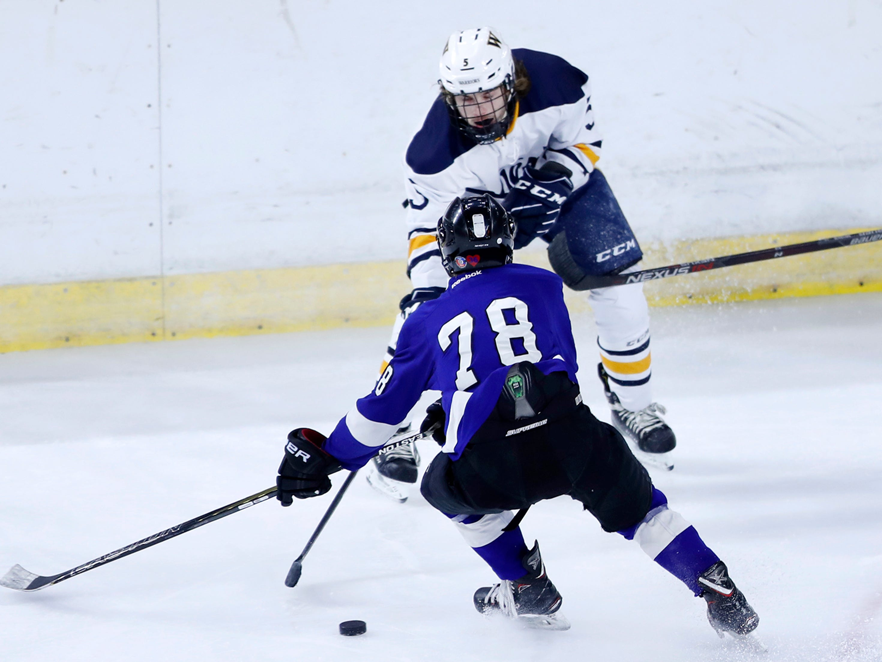 Wausau West's Jacob Cebula slips a pass through the arms of Waukesha North Co-op's Ben Sorge during the WIAA State Hockey Tournament quarterfinals Thursday, Feb. 28, 2019, at Veterans Memorial Coliseum in Madison, Wis.