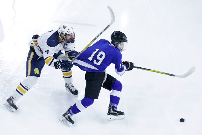 Wausau West's Marc Sippel tugs on the jersey of Waukesha North Co-op's Chad Larsen during the WIAA State Hockey Tournament quarterfinals Thursday, Feb. 28, 2019, at Veterans Memorial Coliseum in Madison, Wis.
