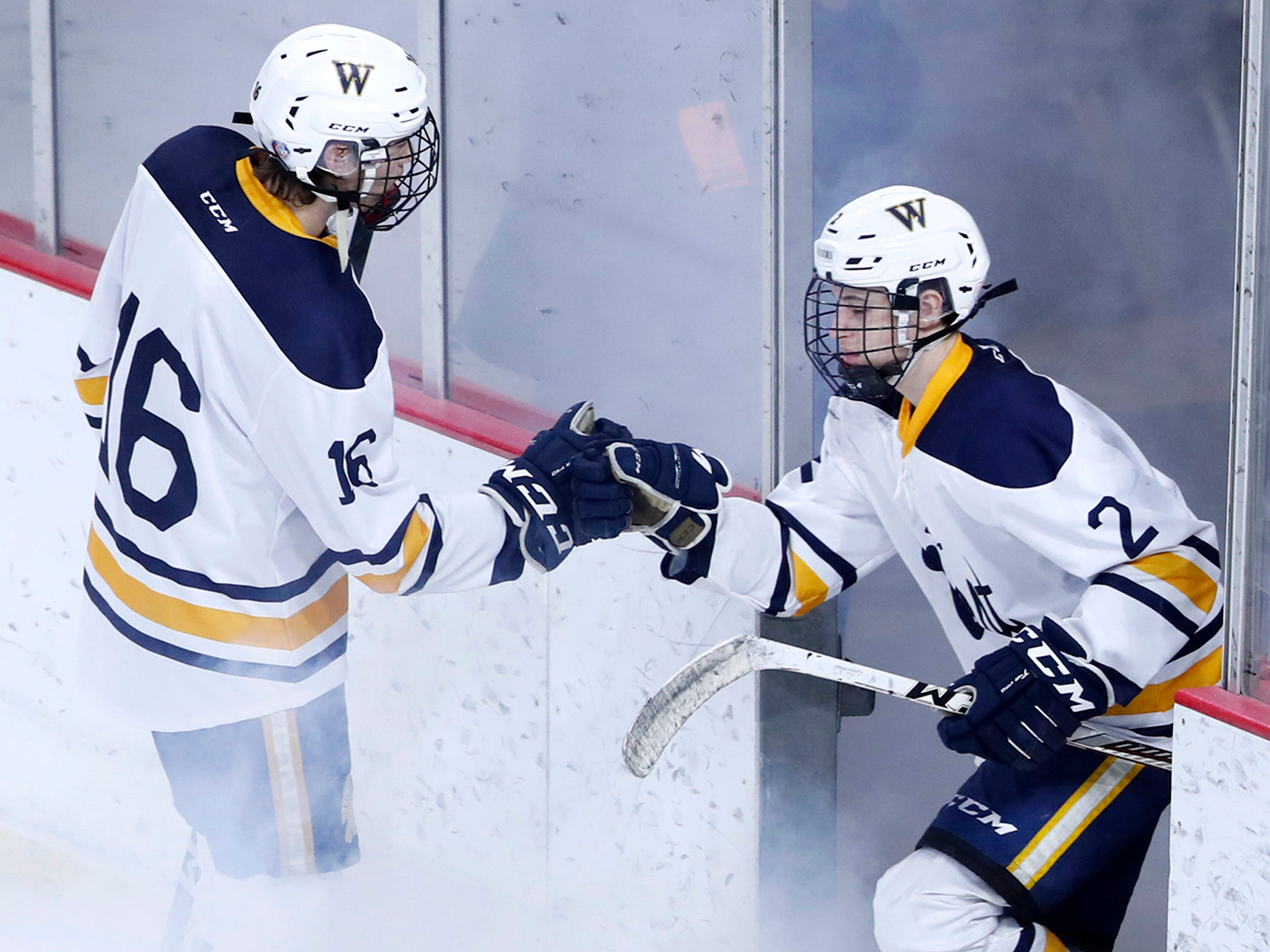 Wausau West's Dayne Hagedorn greets Cade Gruber as he takes to the ice before their WIAA State Hockey Tournament quarterfinal game against Waukesha North Co-op Thursday, Feb. 28, 2019, at Veterans Memorial Coliseum in Madison, Wis.