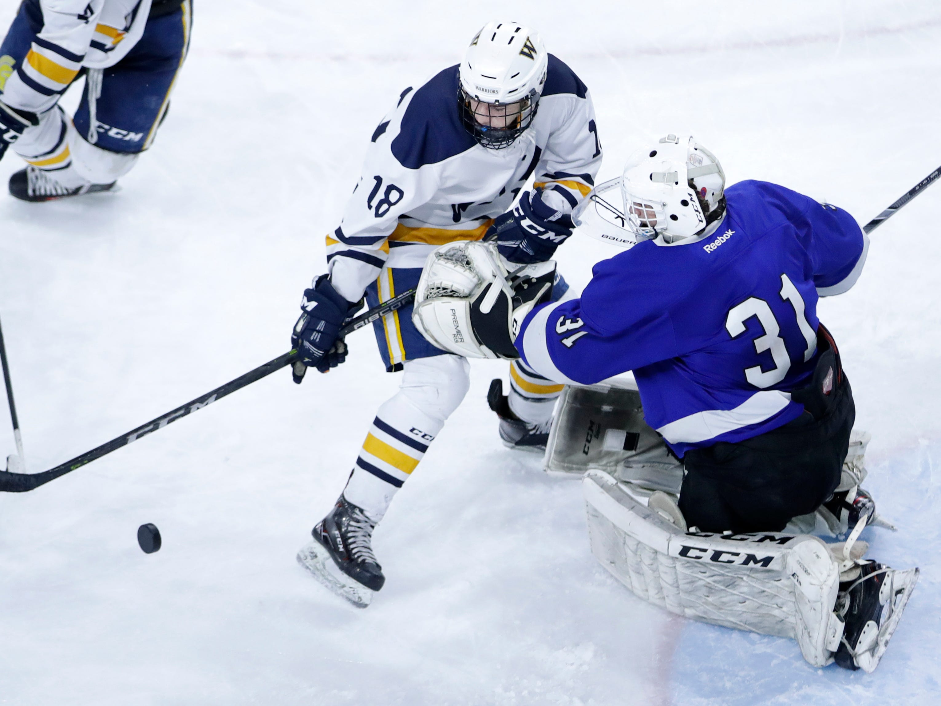 Wausau West's Lucas Langlois tries to control the puck in front of goal against Waukesha North Co-op during the WIAA State Hockey Tournament quarterfinals Thursday, Feb. 28, 2019, at Veterans Memorial Coliseum in Madison, Wis.