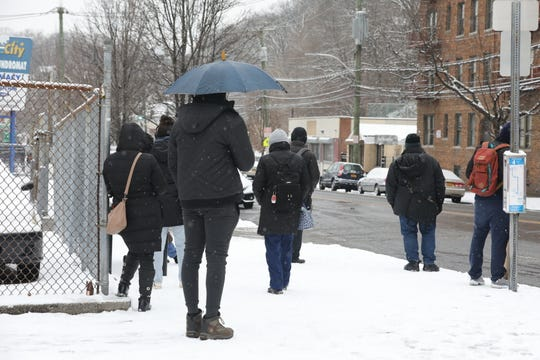 Bee-Line bus customers wait on McLean Avenue in Yonkers as snow covers the sidewalks March 1, 2019.