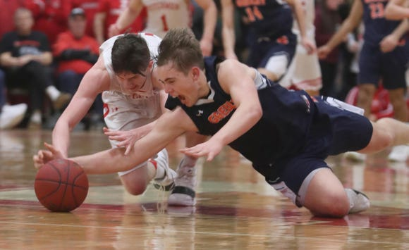Charlie Garrison of Tappan Zee and Nicholas Townsend of Horace Greeley dive for the loose ball during the Class A semifinal basketball game at Tappan Zee High School Feb. 28, 2019. Tappan Zee defeated Horace Greeley 67-60 in double overtime to advance to the Class A championship game.