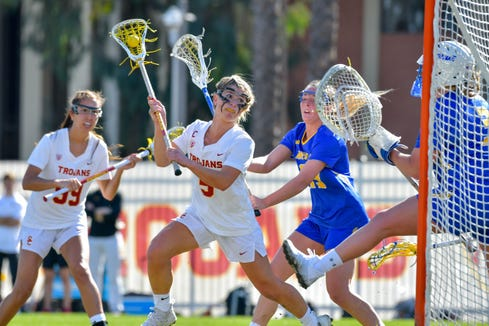 USC's Emily Concialdi, a former Yorktown star, prepares to shoot against Hofstra. She had two goals an an assist, which was part of a week in which she was named Pac 12 women's lacrosse offensive player of the week.