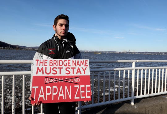 David Dunlop, 17, of Tappan has created a sign that has become popular among those who hope to change the name of the Gov. Mario M. Cuomo Bridge back to the Tappan Zee Bridge. Dunlop was photographed in Piermont with his sign Feb 28, 2019.