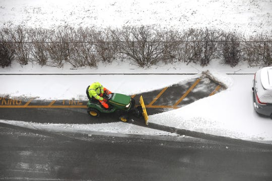 A maintenance worker at the Parkview Owners co-op in Yonkers clears snow from the fire lane on March 1, 2019.