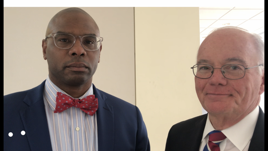 Ex-Stepinac football coach Sheddrick Wilson, left, with his lawyer, Bruce Bendish, following Wilson's acquittal of charges in White Plains City Court