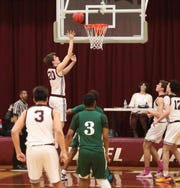 Caravel's Jeb Williams gets open for the final points of the game late in Caravel's 53-50 win in the second round of the DIAA state high school tournament Thursday.