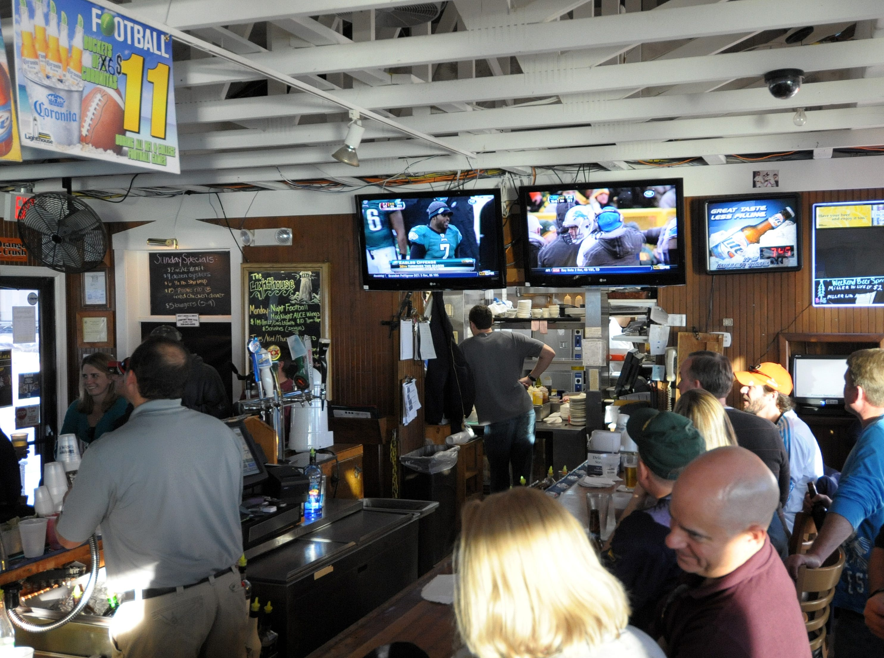 Fans gather at The Lighthouse in Dewey Beach to watch football in 2012.
