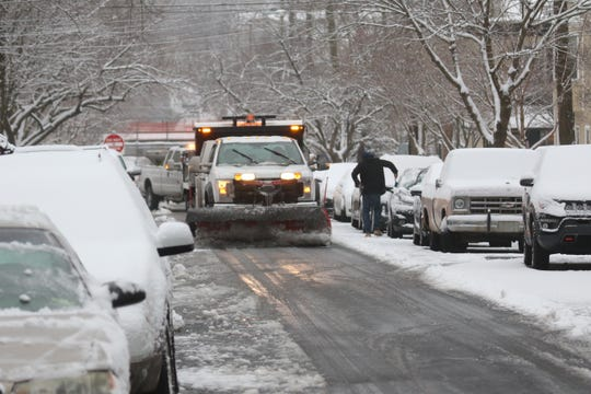 Motorists drive on partially snow-covered roads on Lancaster Pike Friday morning.