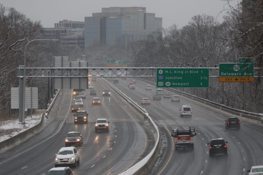 Motorist move along wet slushy I-95 after snow fall passed over the area early Friday morning.