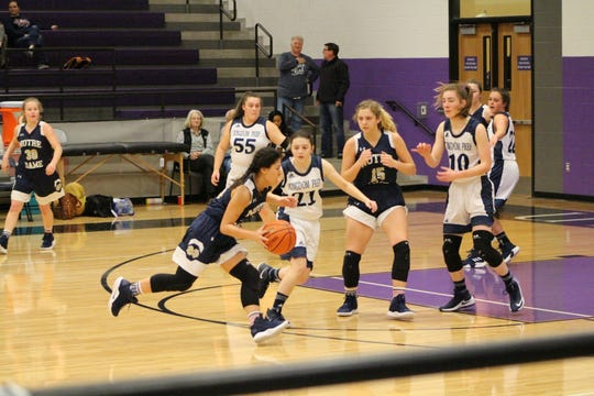 Notre Dame guard Trisha Palomo drives into the lane during the Lady Knights victory against Lubbock Kingdom on Friday.