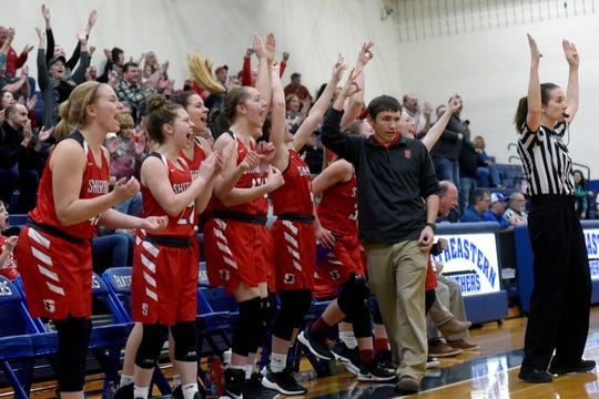 Sheridan's bench comes alive after a 3-pointer by Aubrie White in the third quarter against Circleville. The Generals won, 51-38, to win its second straight district title.