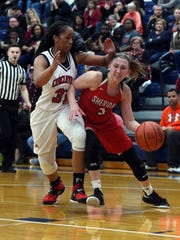 Freshman Bailey Beckstedt drives the baseline on Brie Kendrick during Sheridan's 51-38 win against Circleville in a Division II district final on Tuesday at Chillicothe Southeastern.