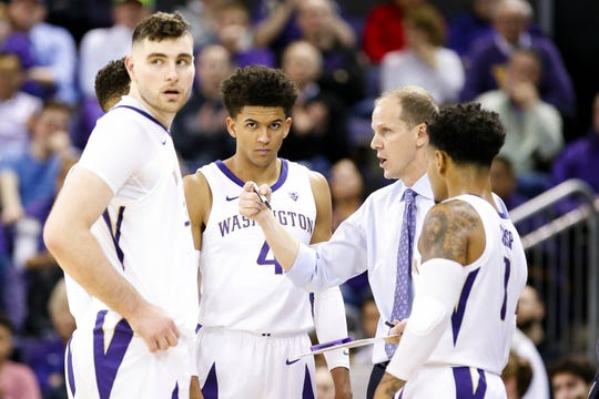 Washington Huskies head coach Mike Hopkins talks with his players, including guard Matisse Thybulle (4) and forward Sam Timmins (33, left) during a timeout this season.