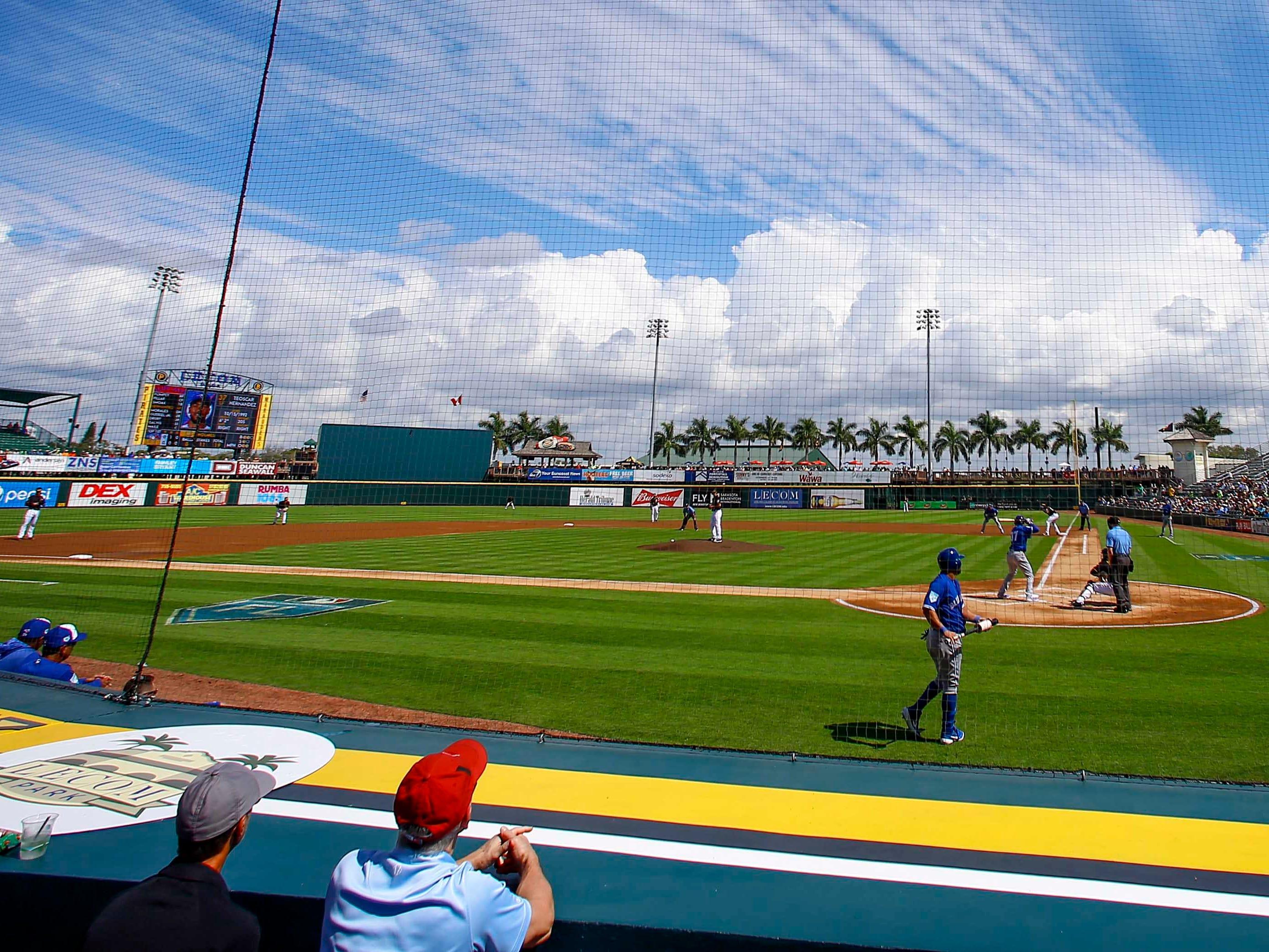 Feb. 27: Fans watch during the first inning of a spring training baseball game between the Pittsburgh Pirates and the Toronto Blue Jays at LECOM Park.