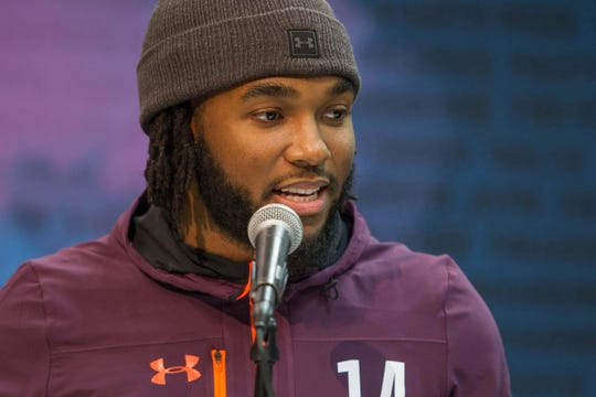 Bryce Love speaks to the media at the combine.