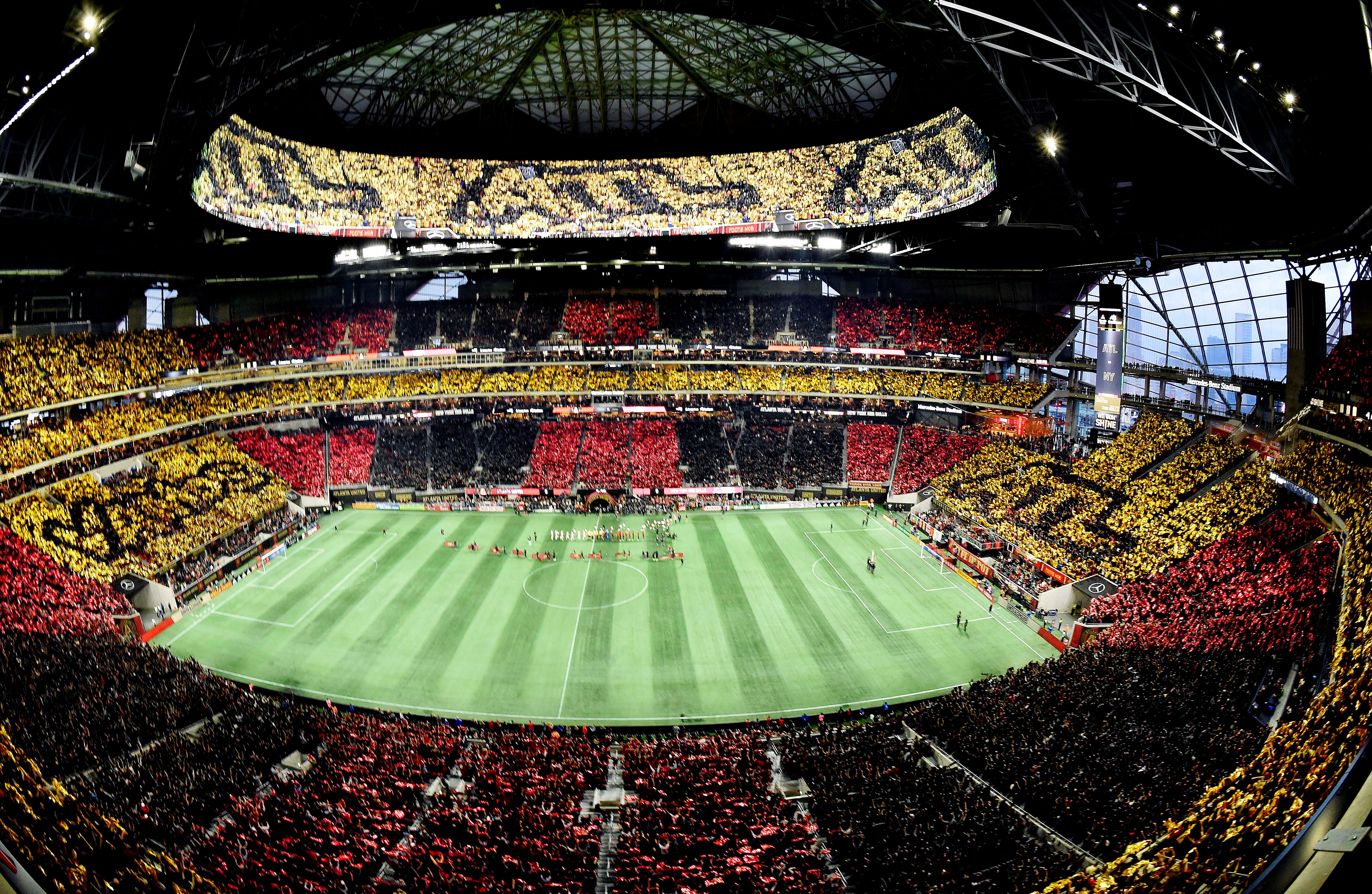 Atlanta United fans perform a tifo stunt prior to the first leg of the MLS Eastern Conference final against the New York Red Bulls at Mercedes-Benz Stadium.