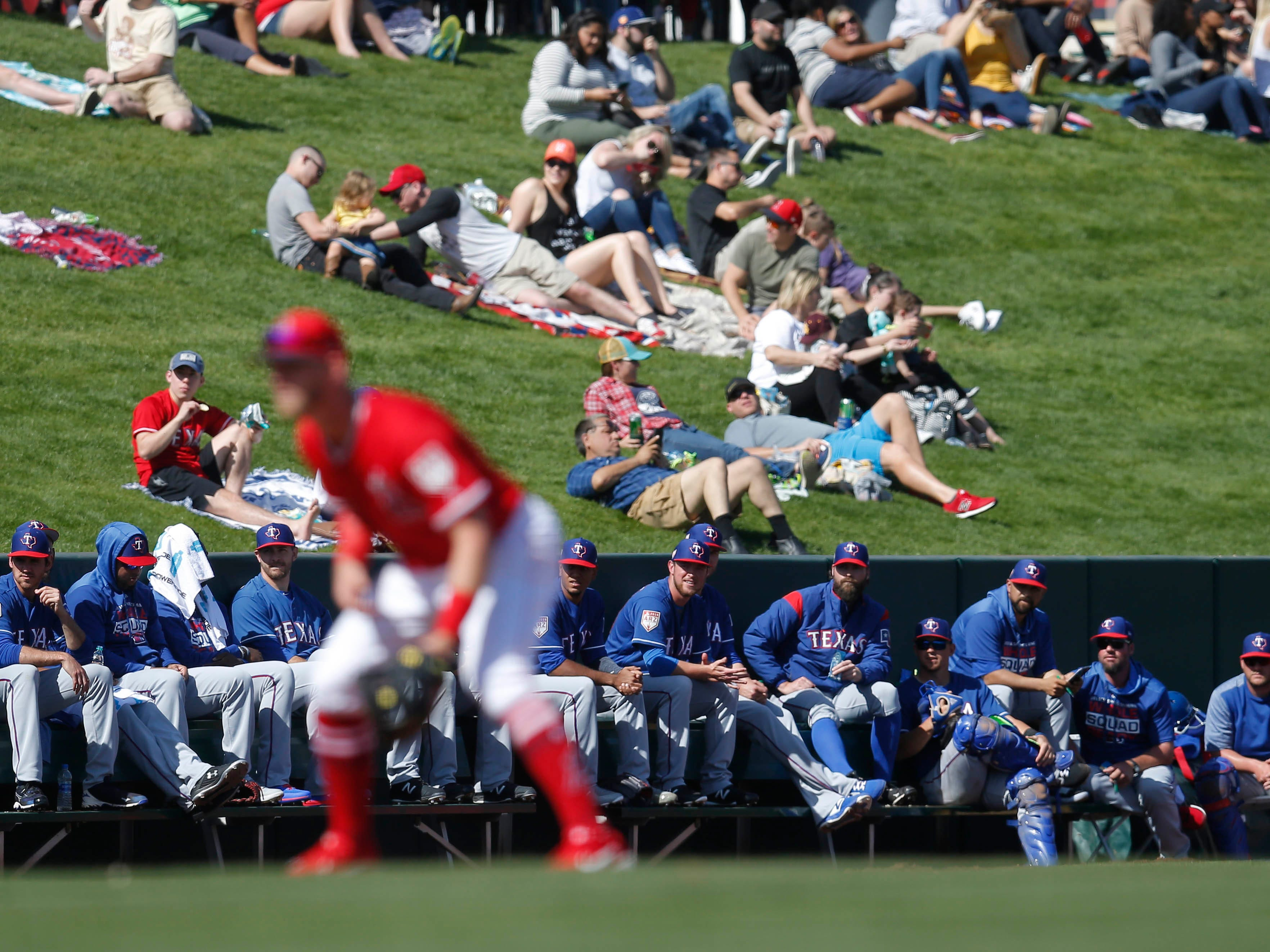 Feb. 28: The Texas Rangers bullpen watches a spring training game against the Los Angeles Angels at Tempe Diablo Stadium.