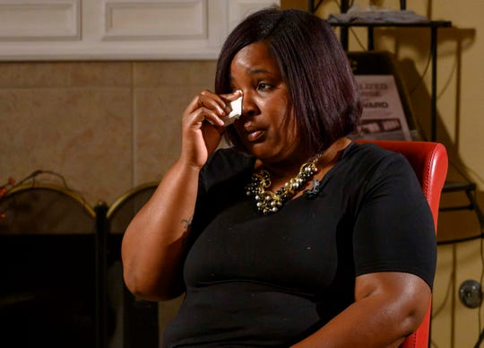 Renata McClendon mourns the death of her sister, Felicia West. West suffered a fatal stroke after giving birth to her son. For hours West's body sent out warning signs, but nobody at the hospital addressed her dangerously high blood pressure until it was too late, a USA TODAY investigation found.