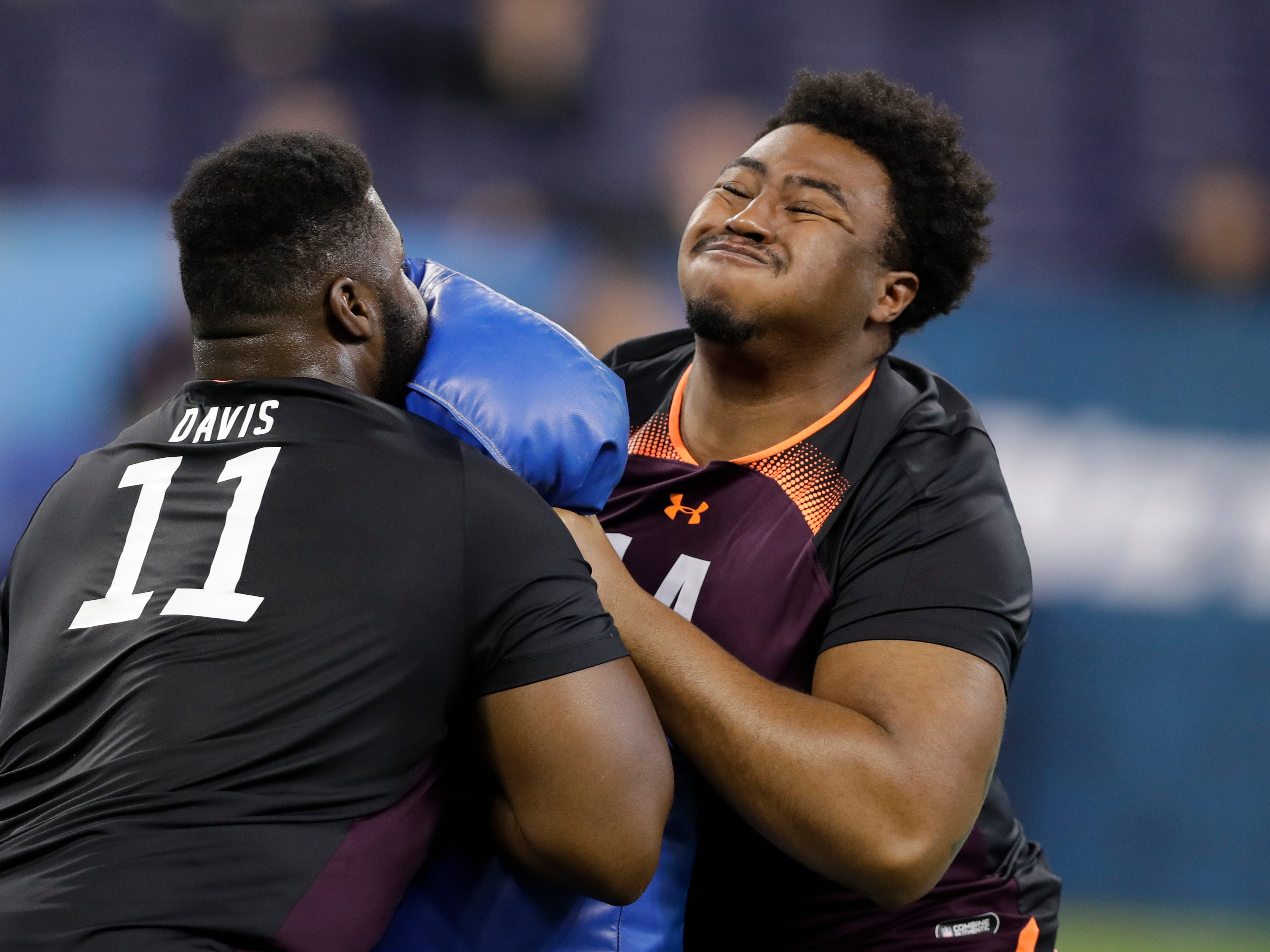 Charlotte offensive lineman Nate Davis, left, and USC offensive lineman Chuma Edoga run a drill during the NFL football scouting combine, Friday, March 1, 2019, in Indianapolis.