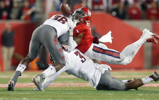 Houston wide receiver Bryson Smith drops the ball after he was hit by Temple linebacker Sam Franklin (36). Franklin was called for targeting and was ejected from the game.