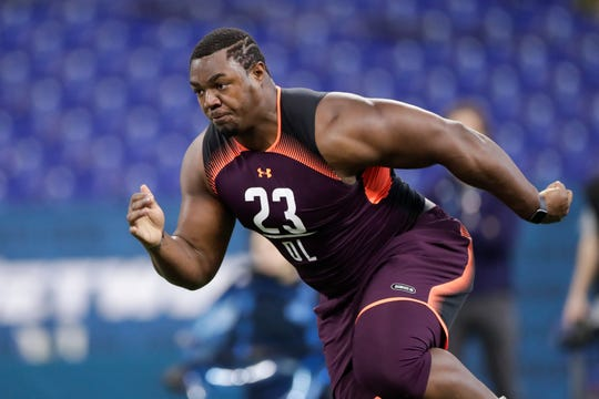 Wake Forest offensive lineman Phil Haynes runs a drill at the NFL football scouting combine in Indianapolis, Friday, March 1, 2019.