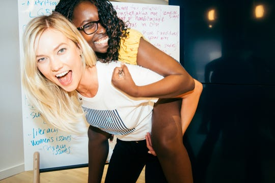 Karlie Kloss founded Kode With Klossy to help give girls the opportunity to learn how to code and become tech leaders themselves. Here, she shares a laugh with with scholar Sofia Ongele at last summer's camp in New York.