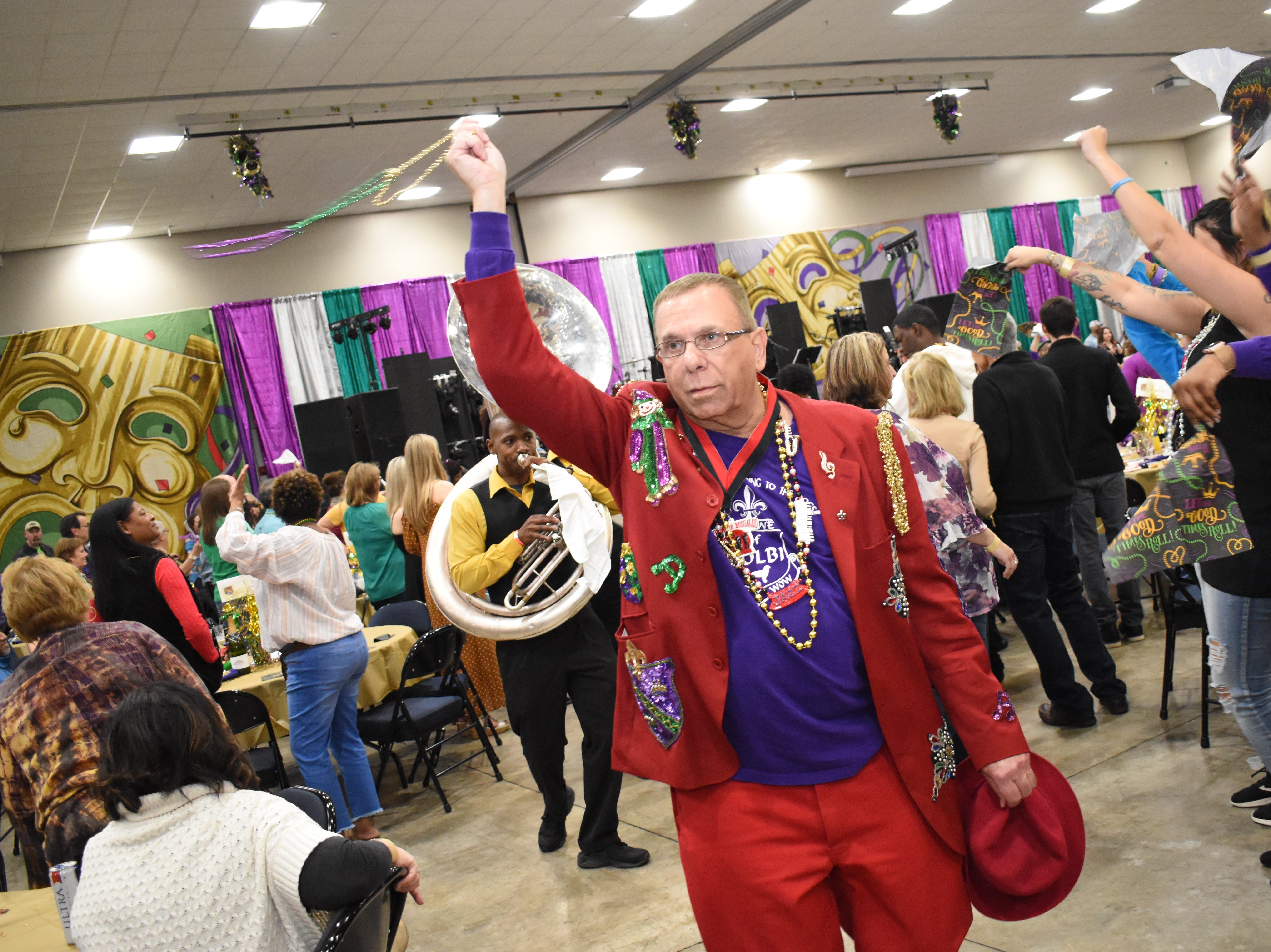 "Greg Gormanous participates in a second led by the Cenla Brass Band at the Louisiana Restaurant Association's Cenla Chapter's annual ""A Taste of Mardi Gras"" Friday, March 1, 2019 at the Alexandria Edward G. 'Ned' Randolph, Jr., Riverfront Center in downtown Alexandria. Local restaurants served ""tastes"" and drinks from their menus while guest enjoyed music, a silent auction and a second line."