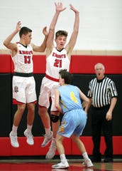 St. Mary's Max Griffith (4) looks for an opening against Lourdes'  Caden Chier (13) and George Muench (21) during a WIAA Division 4 boys basketball regional semifinal Friday.