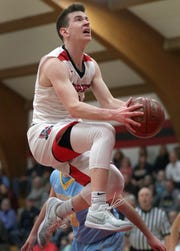Lourdes Academy's Henry Noone drives against Menasha St. Mary's during their WIAA Division 4 boys basketball regional semifinal Friday at Lourdes Academy in Oshkosh.