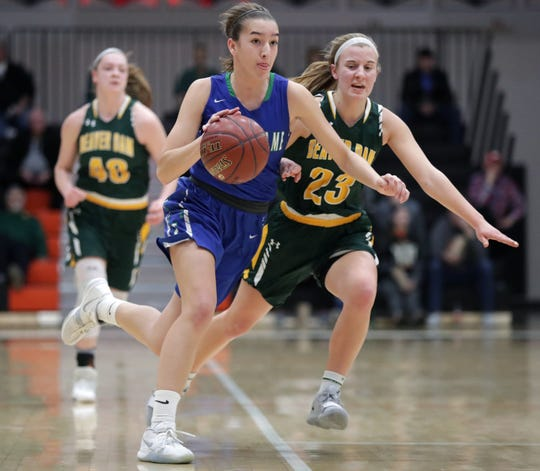 Notre Dame High School's #3 Sarah Hardwick against Beaver Dam High School's #23 Rachel Uhrick during their WIAA Division 2 girls basketball sectional final on Saturday, March 2, 2019, at Kaukauna High School in Kaukauna, Wis. Beaver Dam defeated Notre Dame 68 to 40.
