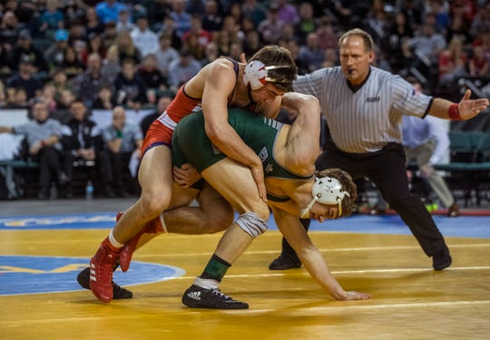Robert Kanniard of Wall (left) works for a takedown on his way to winning the NJSIAA 160-pound championship Saturday at Boardwalk Hall, Atlantic City.