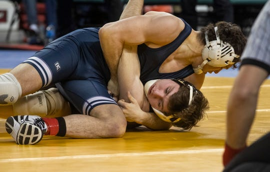 Pope John's Robert Garcia has Southern's Nicholas O'Connell on his back during the 152-pound state final. Garcia won 13-5.