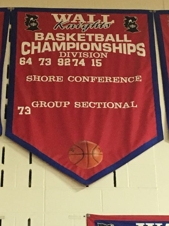 The Wall boys basketball championship banner that hangs in the gymnasium