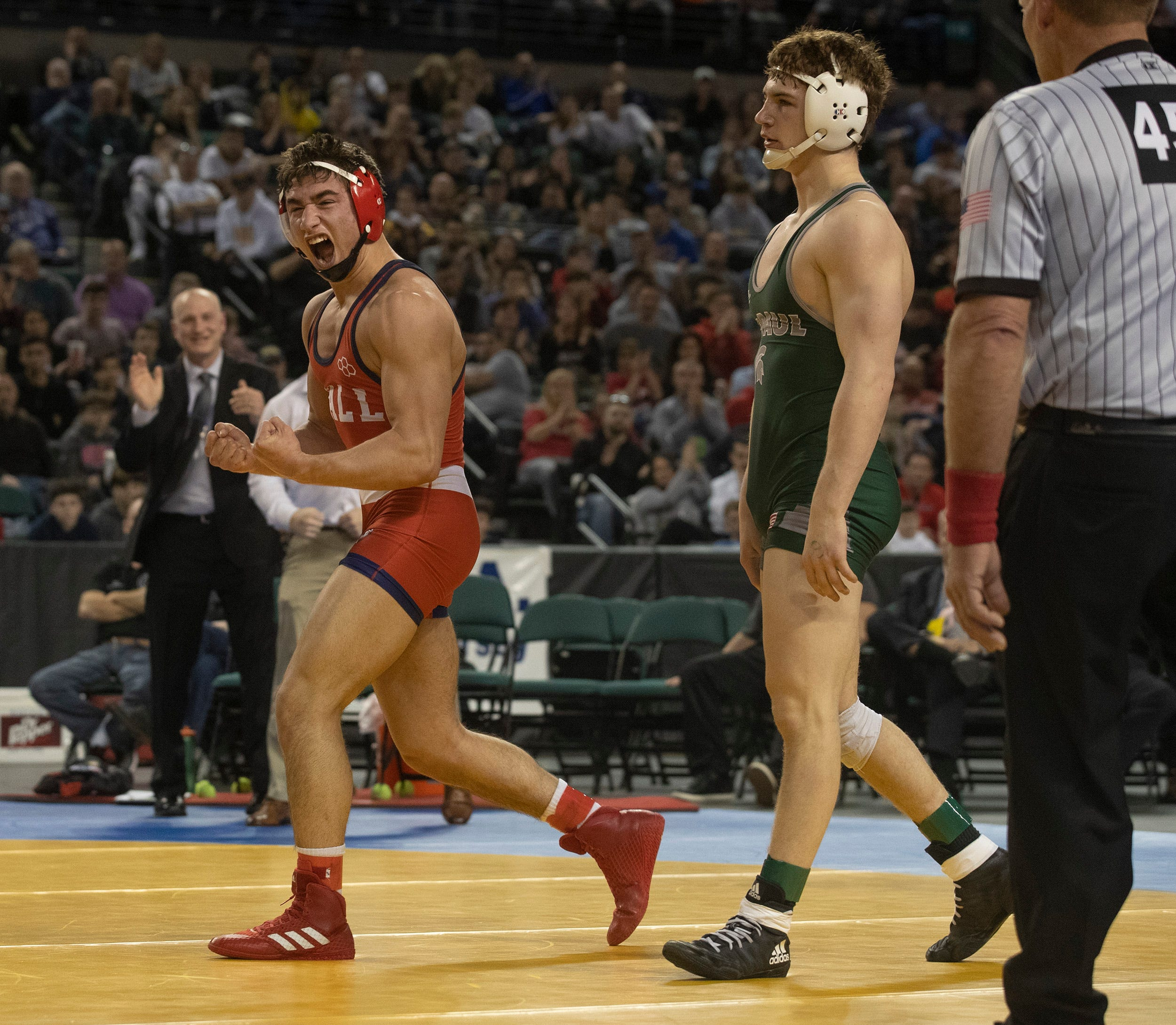Robert Kanniard of Wall celebrates as he wins the NJSIAA 160-pound championship Saturday afternoon at Boardwalk Hall, Atlantic City.