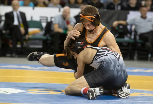 Hunterdon Central's Brett Ungar (right) has a hold of the leg of Middletown North's Tyler Klinsky on his way to winning the NJSIAA 106-pund championship Saturday at Boardwalk Hall, Atlantic City.