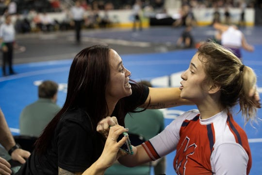 Manalapan's Jesse Johnson celebrates with her mom after  pinning Manasquan's America Garay in their 136 lbs bout. NJSIAA State Girls Wrestling semifinal matches on Friday March 1, 2019 in Atlantic City.