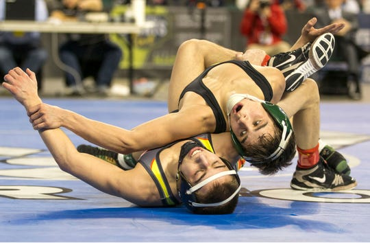 Brick Memorial's Vincent Santaniello and Bergen Catholic's Nick Kayal were involved in several wild scrambles during the 113-pound third-place bout. Santaniello won 9-4 on a reversal and three back points in the final seconds.