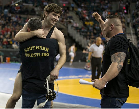 Southern's Nicholas O'Connell jumps in the arms of Rams' assistant coach Dan Roy after he defeated Phillipsburg's Cody Harrison in the 152-pound semifinal Friday night.
