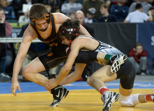Hunterdon Central's Brett Ungar (right) works for a takedown against Middletown North's Tyler Klinsky on his way to a 13-6 win in the 106-pound championship bout of the NJSIAA Individual Wrestling Championships Saturday at Boardwalk Hall, Atlantic City