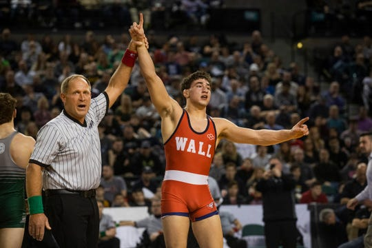 Wall senior 160-pounder Robert Kanniard has his hand raised by referee Ed Tonnessen after winning the NJSIAA 160-pound championship Saturday at Boardwalk Hall, Atlantic City.