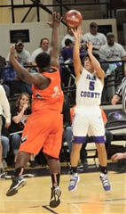 Irion County's Nathan Chacon, right, shoots over a Paducah defender. Irion County won the Region II-1A semifinal game 69-58 on Friday, March 1, 2019, at Abilene Christian's Moody Coliseum.
