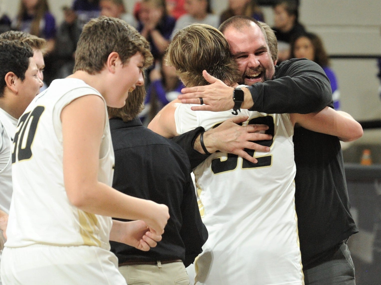 Jayton assistant coach Josh Stanaland, right, hugs Tye Scogin after the Jaybirds beat Irion County 47-32 in the Region II-1A championship game Saturday, March 2, 2019, at Abilene Christian's Moody Coliseum. It's Jayton's first state berth.