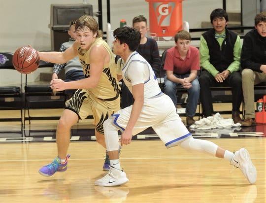 Jayton's Tye Scogin, left, drives toward the basket as Eden's Donovan Gonzales defends. Jayton won the Region II-1A semifinal game 58-25 on Friday, March 1, 2019, at Abilene Christian's Moody Coliseum.