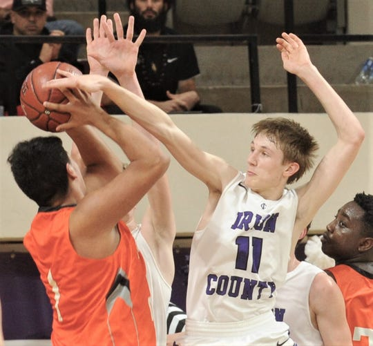 Irion County's Dawson Sparks (11) defends against Paducah's Isaac Garibaldi. Irion County won the Region II-1A semifinal game 69-58 on Friday, March 1, 2019, at Abilene Christian's Moody Coliseum.