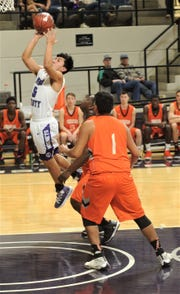 Irion County's Nathan Chacon, left, drives to the basket as Paducah's Isaac Garibaldi and another teammate defend. Irion County won the Region II-1A semifinal game 69-58 on Friday, March 1, 2019, at Abilene Christian's Moody Coliseum.