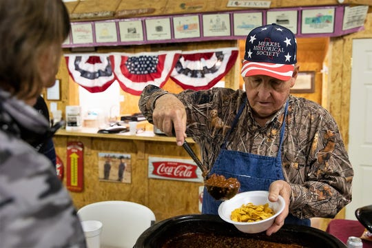 Volunteer Billy Bob Neff fills a bowl with chili at the Merkel Area Historical Museum, where Texas Independence Day was celebrated Saturday.
