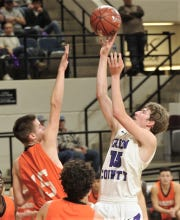 Irion County's Avery Theeck, right, shoots over Paducah's Tate Hutchinson. Irion County won the Region II-1A semifinal game 69-58 on Friday, March 1, 2019, at Abilene Christian's Moody Coliseum.